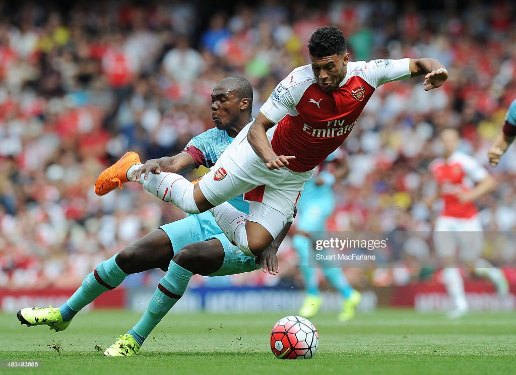 Alex Oxlade-Chamberlain of Arsenal challenged by Angelo Ogbonna of West Ham during the Barclays Premier League match between Arsenal and West Ham United at Emirates Stadium on August 9, 2015 in London, England.