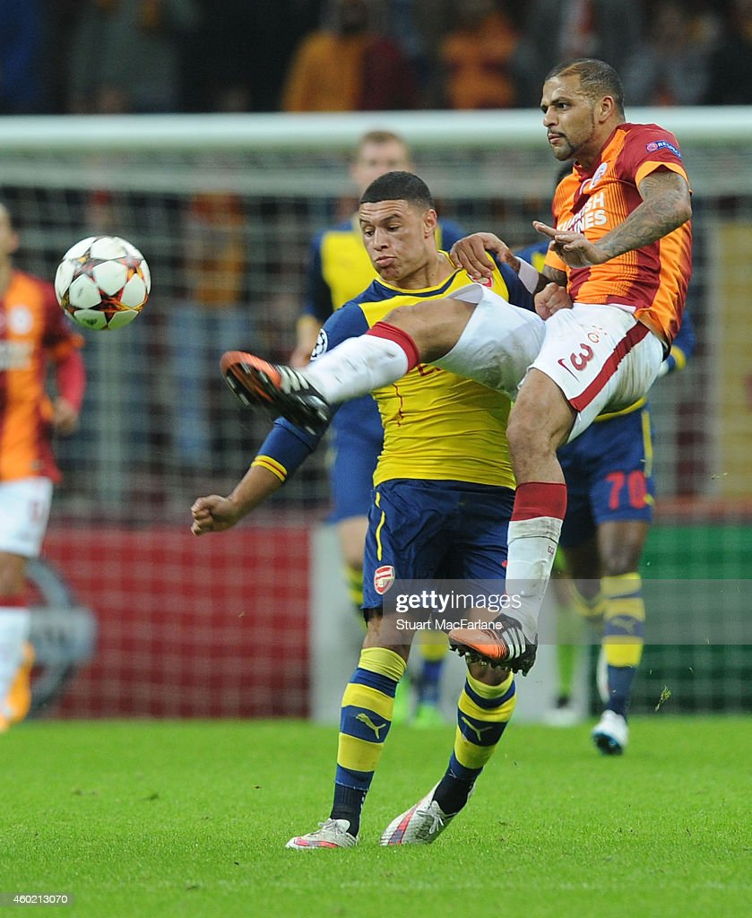 Alex Oxlade-Chamberlain of Arsenal challenged by Felipe Melo during the UEFA Champions League match between Galatasaray and Arsenal at the Turk Telekom Arena on December 9, 2014 in Istanbul, Turkey.
