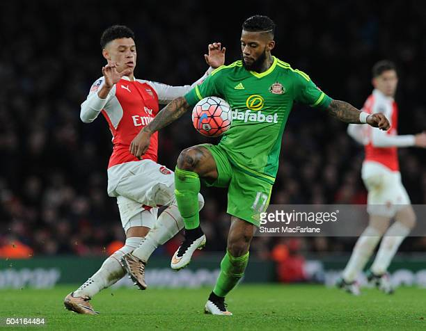 Alex OxladeChamberlain of Arsenal challenges Jermain Lens of Sunderland during the Emirates FA Cup Third Round match between Arsenal and Sunderland...