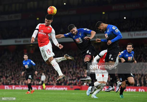 Alex OxladeChamberlain of Arsenal heads the ball during the Barclays Premier League match between Arsenal and AFC Bournemouth at Emirates Stadium on...