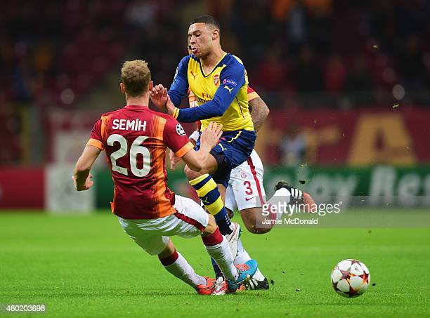 Alex OxladeChamberlain of Arsenal is blocked by Semih Kaya of Galatasaray during the UEFA Champions League Group D match between Galatasaray AS and...