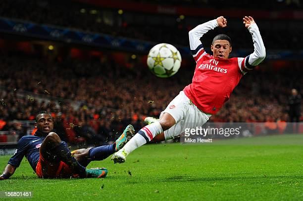 Alex Oxlade-Chamberlain of Arsenal is brought down by Henri Bedimo Nsame of Montpellier during the UEFA Champions League group B match between...