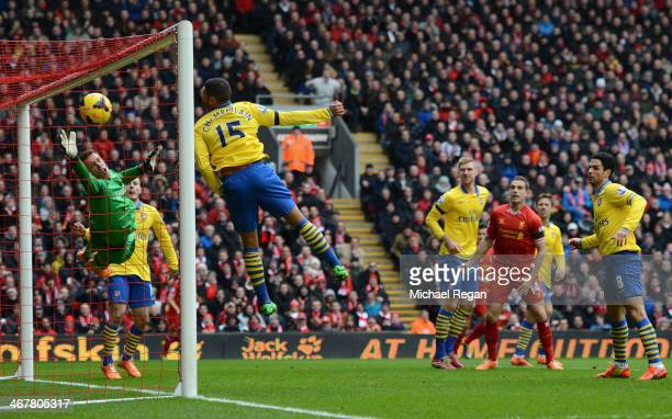 Alex OxladeChamberlain of Arsenal is unable to stop Martin Skrtel of Liverpool scoring the second goal during the Barclays Premier League match...
