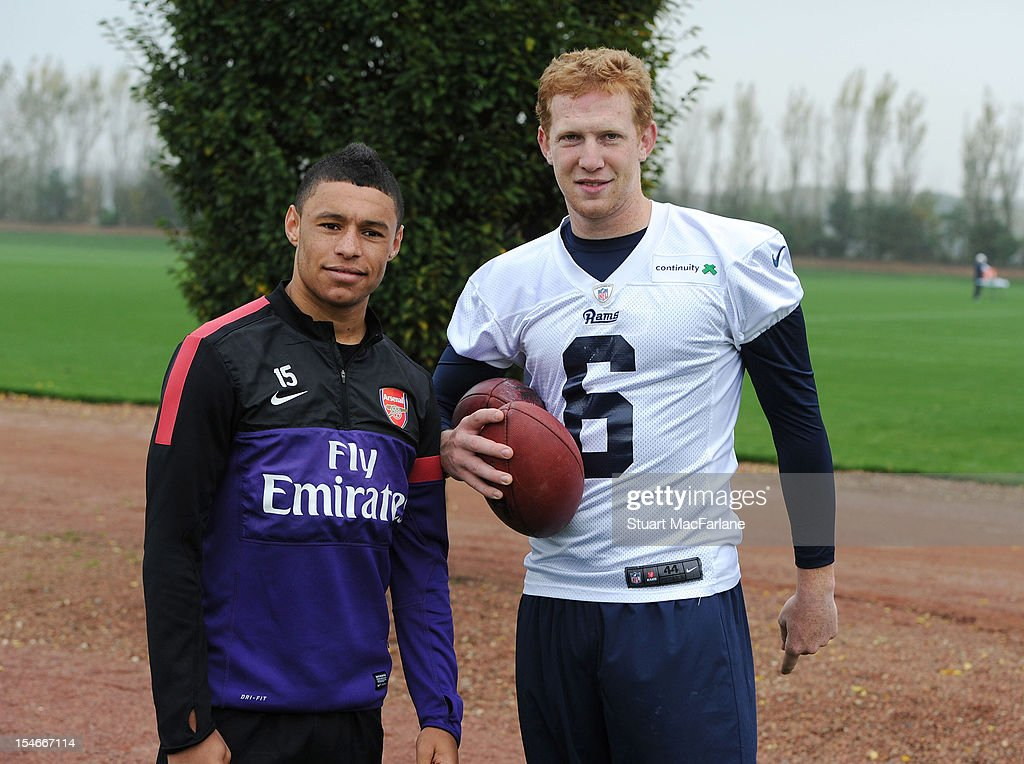 Alex Oxlade-Chamberlain of Arsenal poses with Johnny Hekker of the St Louis Rams at London Colney on October 24, 2012 in St Albans, England.