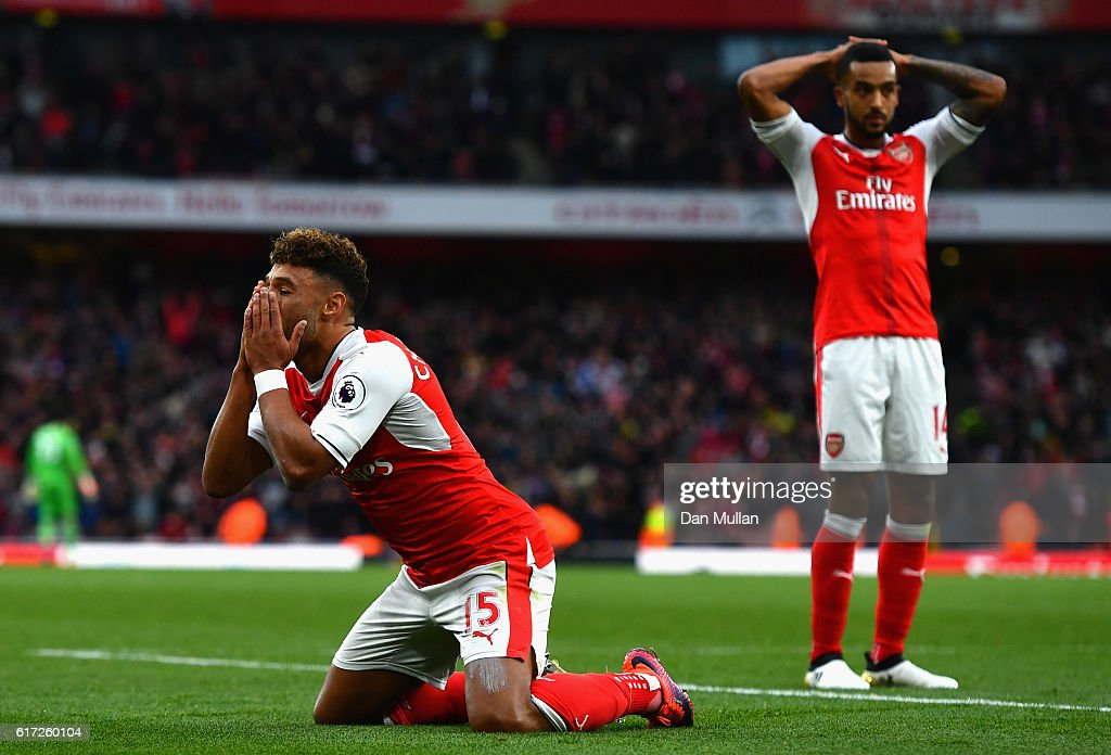 Alex Oxlade-Chamberlain of Arsenal (C) reacts to Arsenal having a goal disallowed during the Premier League match between Arsenal and Middlesbrough at Emirates Stadium on October 22, 2016 in London, England.
