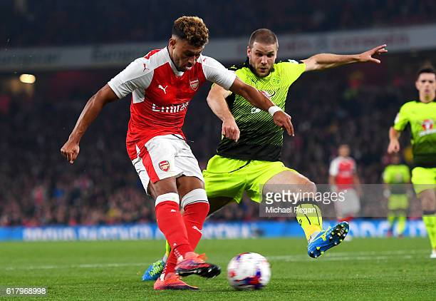 Alex OxladeChamberlain of Arsenal scores his sides first goal during the EFL Cup fourth round match between Arsenal and Reading at Emirates Stadium...