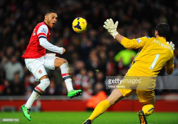 Alex OxladeChamberlain of Arsenal scores the first goal past Julian Speroni of Crystal Palace during the Barclays Premier League match between...