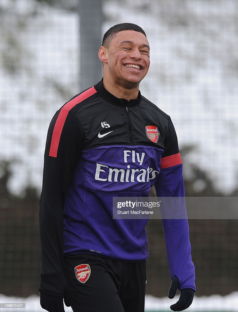 Alex Oxlade-Chamberlain of Arsenal smiles during a training session at London Colney on January 22, 2013 in St Albans, England.