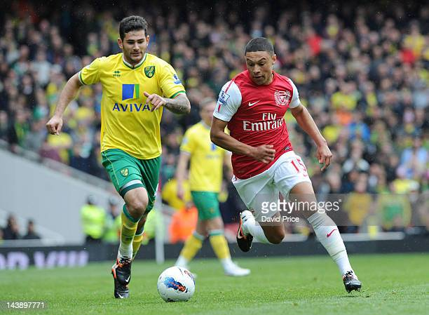Alex Oxlade-Chamberlain of Arsenal takes on Bradley Johnson of Norwich during the Barclays Premier League match between Arsenal and Norwich City at...