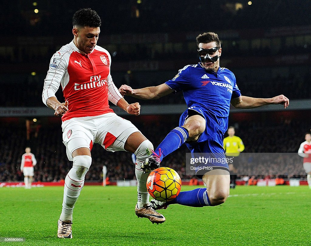 Alex Oxlade-Chamberlain of Arsenal takes on Cesar Azpilicueta of Chelsea during the Barclays Premier League match between Arsenal and Chelsea Emirates Stadium on January 24, 2016 in London, England.
