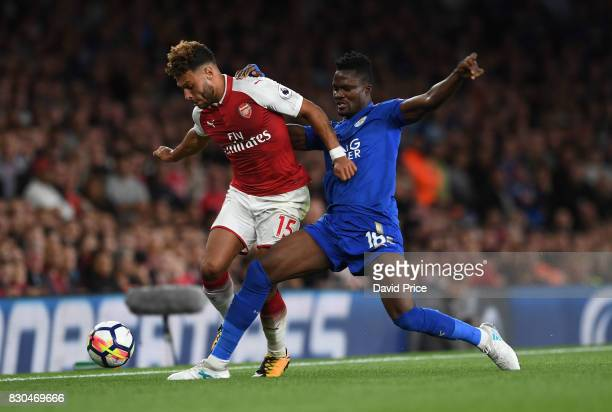 Alex OxladeChamberlain of Arsenal takes on Daniel Amartey of Leicester during the Premier League match between Arsenal and Leicester City at Emirates...