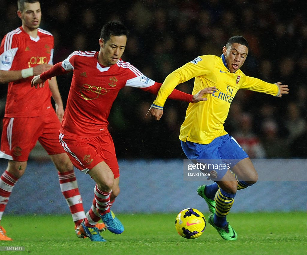 Alex Oxlade-Chamberlain of Arsenal takes on Maya Yoshida of Southampton during the match between Southampton and Arsenal at St Mary's Stadium on January 28, 2014 in Southampton, England.