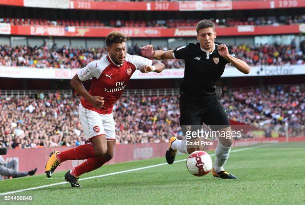 Alex OxladeChamberlain of Arsenal takes on Sebastien Corchia of Sevilla during the match between Arsenal and Sevilla at Emirates Stadium on July 30...