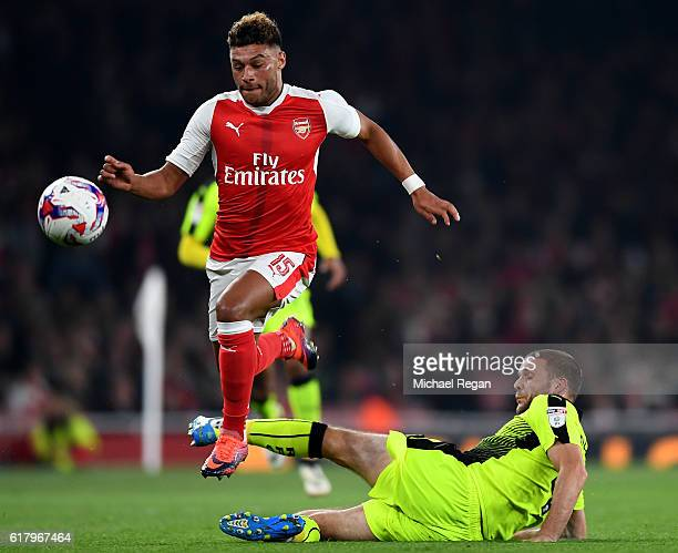 Alex OxladeChamberlain of Arsenal takes the ball past Joey van den Berg of Reading during the EFL Cup fourth round match between Arsenal and Reading...