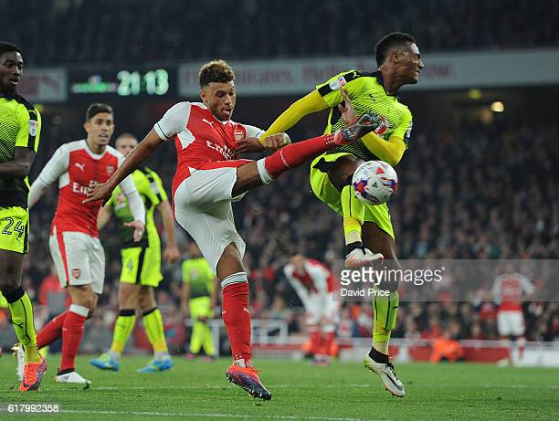 Alex OxladeChamberlain of Arsenal volleys under pressure from Sandro Wieser of Reading during the match between Arsenal and Reading at Emirates...