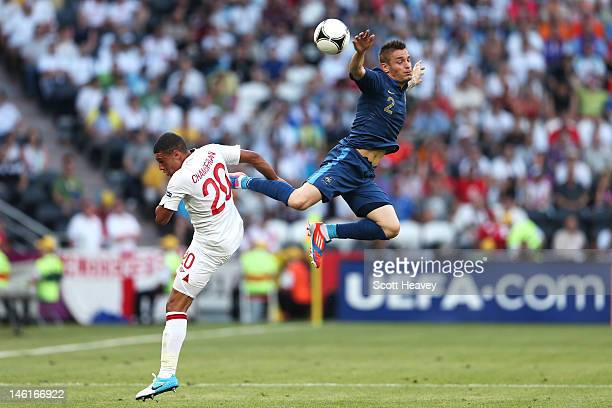 Alex Oxlade-Chamberlain of England and Mathieu Debuchy of France battle for the ball during the UEFA EURO 2012 group D match between France and...