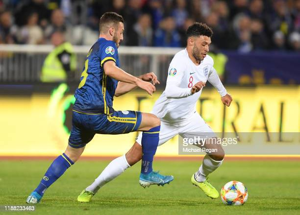 Alex OxladeChamberlain of England battles for possession with Fidan Aliti of Kosovo during the UEFA Euro 2020 Qualifier between Kosovo and England at...
