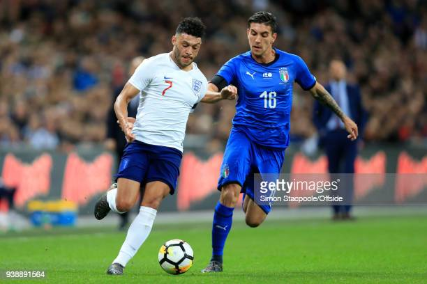 Alex OxladeChamberlain of England battles with Lorenzo Pellegrini of Italy during the international friendly match between England and Italy at...