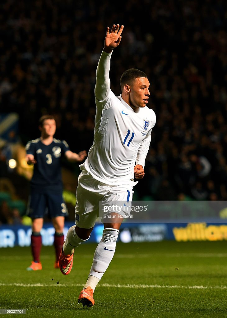 Alex Oxlade-Chamberlain of England celebrates after scoring the opening goal during the International Friendly match between Scotland and England at Celtic Park Stadium on November 18, 2014 in Glasgow, Scotland.
