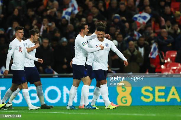 Alex OxladeChamberlain of England celebrates scoring his sides first goal during the UEFA European Championship Group A Qualifying match between...