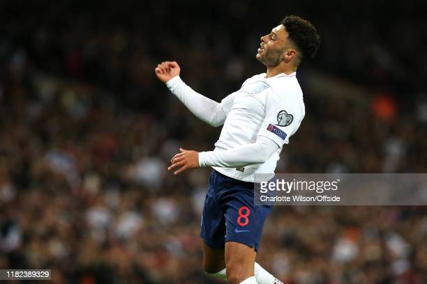 Alex OxladeChamberlain of England celebrates scoring the opening goal during the UEFA Euro 2020 qualifier between England and Montenegro at Wembley...