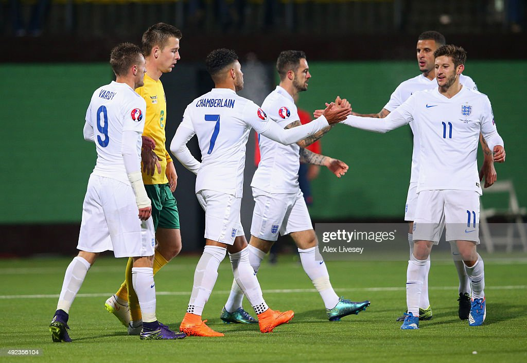 Alex Oxlade-Chamberlain of England (7) celebrates with Adam Lallana (11) as he scores their third goal during the UEFA EURO 2016 qualifying Group E match between Lithuania and England at LFF Stadionas on October 12, 2015 in Kaunas, Lithuania.