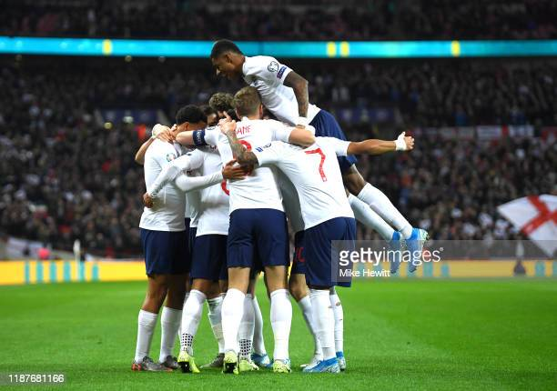 Alex Oxlade-Chamberlain of England celebrates with team mates after scoring his sides first goal during the UEFA Euro 2020 qualifier between England...