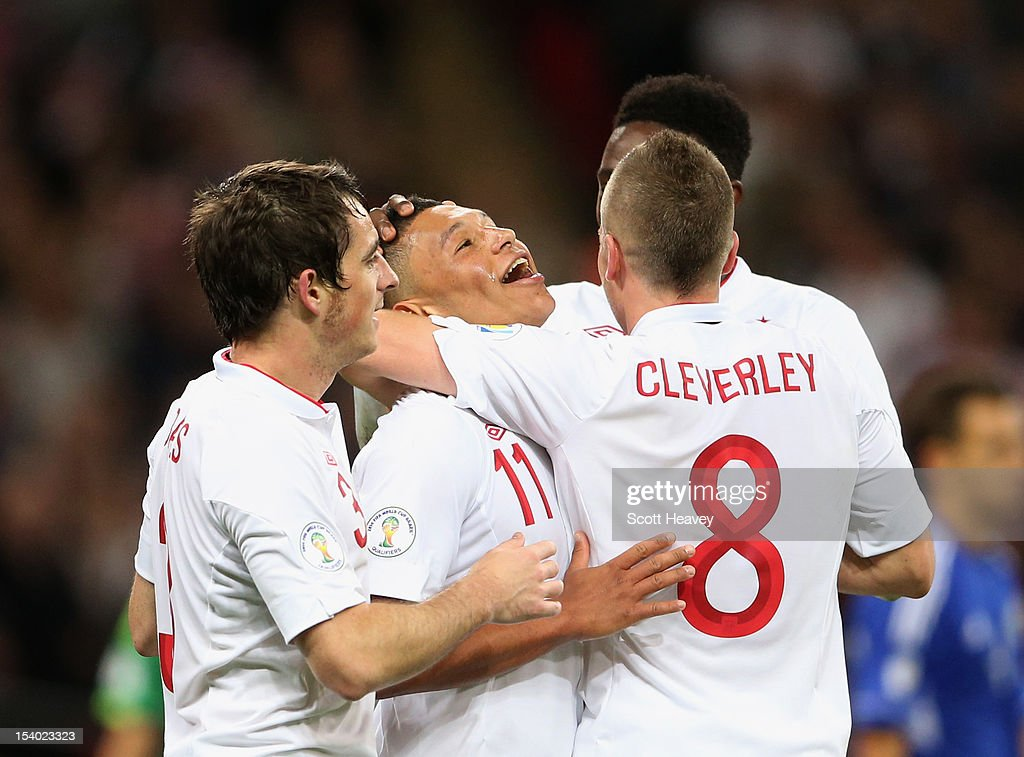 Alex Oxlade-Chamberlain of England celebrates with team-mates (L-R) Leighton Baines, Tom Cleverley and Danny Welbeck after scoring his team's fifith goal during the FIFA 2014 World Cup Group H qualifying match between England and San Marino at Wembley Stadium on October 12, 2012 in London, England.