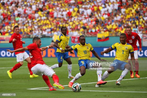 Alex OxladeChamberlain of England has his effort blocked by Walter Ayovi and Jorge Guagua of Ecuador during the International friendly match between...