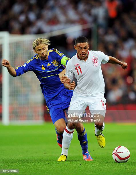 Alex Oxlade-Chamberlain of England is challenged by Anatoliy Tymoshchuk of Ukraine during the FIFA 2014 World Cup qualifier group H match between...
