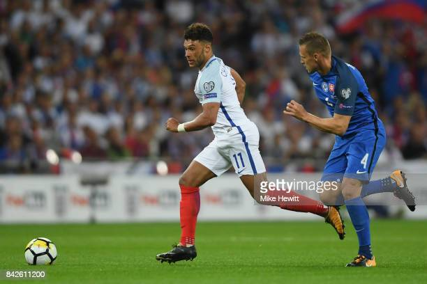 Alex OxladeChamberlain of England is chased by Jan Durica of Slovakia during the FIFA 2018 World Cup Qualifier between England and Slovakia at...
