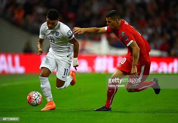 Alex OxladeChamberlain of England is marshalled by Granit Xhaka of Switzerland during the UEFA EURO 2016 Group E qualifying match between England and...