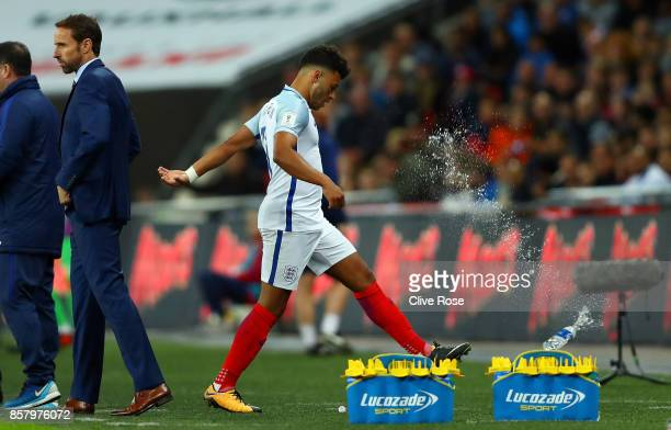 Alex OxladeChamberlain of England reacts by kicking a bottle as he is substituted during the FIFA 2018 World Cup Group F Qualifier between England...