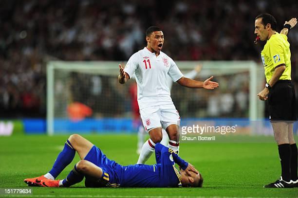 Alex OxladeChamberlain of England reacts towards referee Cuneyt Cakir as Jermaine Defoe's goal is disallowed for a foul on Andriy Yarmolenko of...