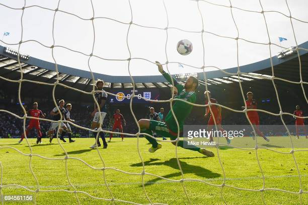 Alex Oxlade-Chamberlain of England scores his sides first goal past Craig Gordon of Scotland during the FIFA 2018 World Cup Qualifier between...