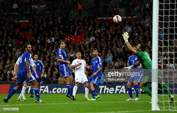 Alex OxladeChamberlain of England scores his team's fifith goal during the FIFA 2014 World Cup Group H qualifying match between England and San...