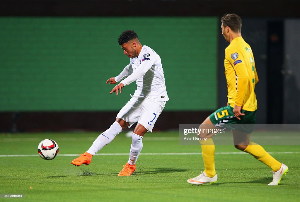 Alex Oxlade-Chamberlain of England scores their third goal as Tomas Mikuckis of Lithuania looks on during the UEFA EURO 2016 qualifying Group E match between Lithuania and England at LFF Stadionas on October 12, 2015 in Kaunas, Lithuania.