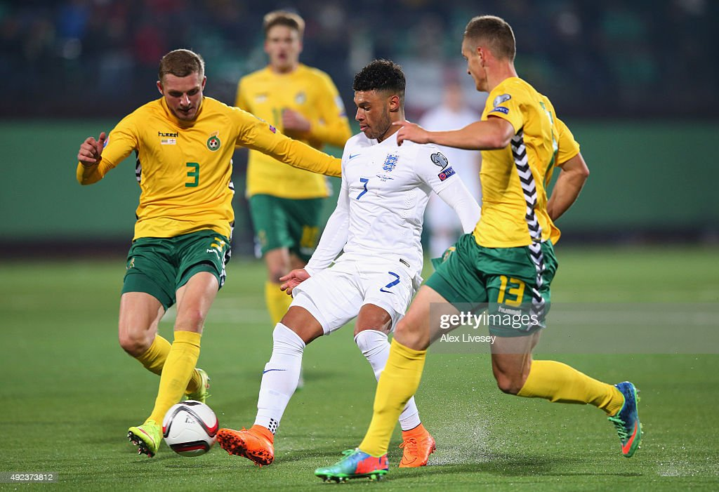 Alex Oxlade-Chamberlain of England takes on Georgas Freidgeimas (3) and Deimantas Petravicius of Lithuania (13) during the UEFA EURO 2016 qualifying Group E match between Lithuania and England at LFF Stadionas on October 12, 2015 in Kaunas, Lithuania.