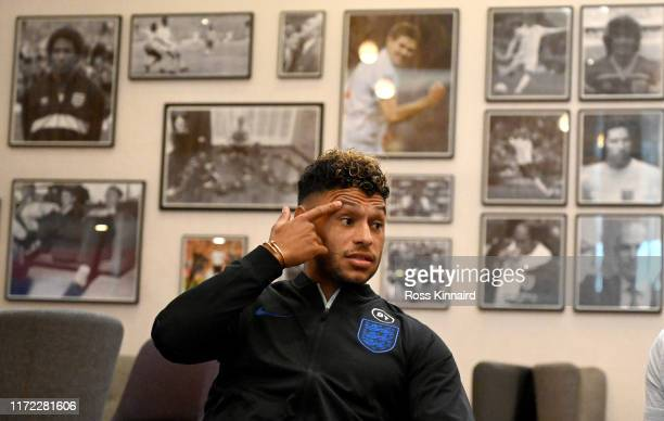 Alex Oxlade-Chamberlain of England talking to the media during a press conference at St Georges Park on September 04, 2019 in Burton-upon-Trent,...