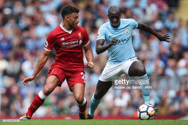 Alex OxladeChamberlain of Liverpool and Benjamin Mendy of Manchester City during the Premier League match between Manchester City and Liverpool at...