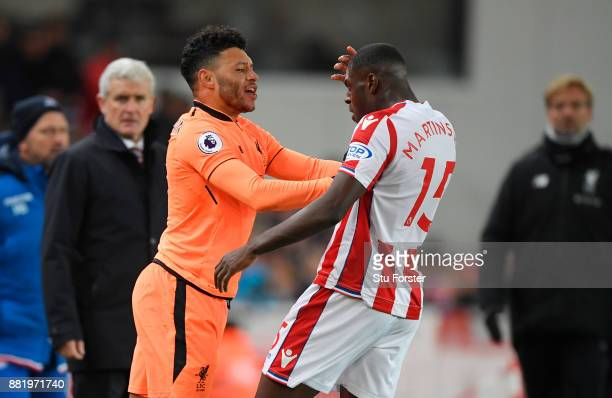 Alex OxladeChamberlain of Liverpool and Bruno Martins Indi of Stoke City clash during the Premier League match between Stoke City and Liverpool at...