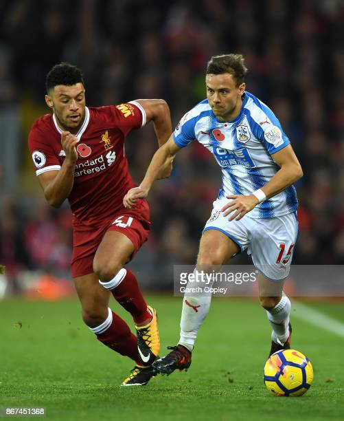 Alex OxladeChamberlain of Liverpool and Chris Lowe of Huddersfield Town battle for possession during the Premier League match between Liverpool and...