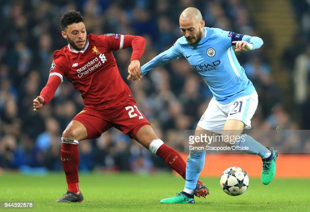Alex OxladeChamberlain of Liverpool and David Silva of Man City battle for the ball during the UEFA Champions League Quarter Final Second Leg match...