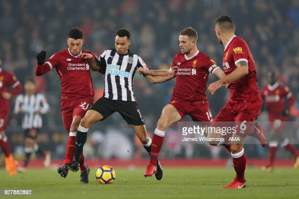 Alex OxladeChamberlain of Liverpool and Jacob Murphy of Newcastle United and Jordan Henderson of Liverpool during the Premier League match between...