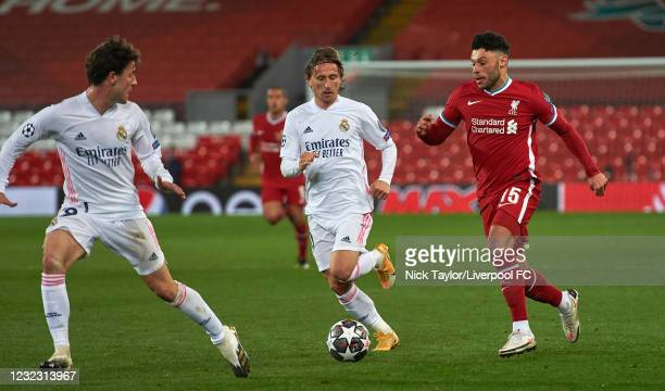 Alex Oxlade-Chamberlain of Liverpool and Luka Modric and Alvaro Odriozola of Real Madrid in action during the UEFA Champions League Quarter Final...