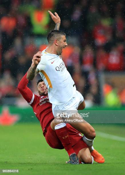 Alex OxladeChamberlain of Liverpool appears to injure his right knee in this challenge on Aleksandar Kolarov of ASRoma during the UEFA Champions...
