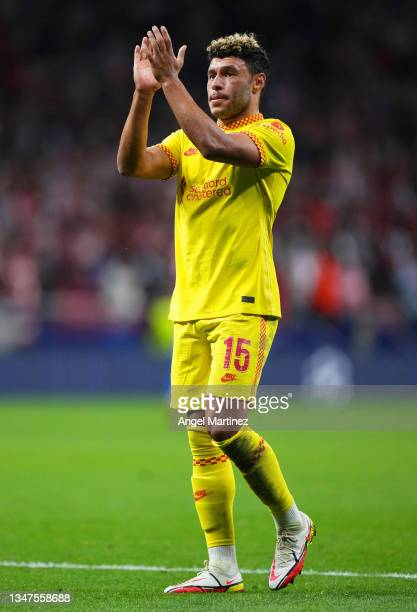 Alex Oxlade-Chamberlain of Liverpool applauds the fans after the UEFA Champions League group B match between Atletico Madrid and Liverpool FC at...