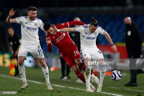 Alex Oxlade-Chamberlain of Liverpool battles for possession with Jack Harrison of Leeds United during the Premier League match between Leeds United...