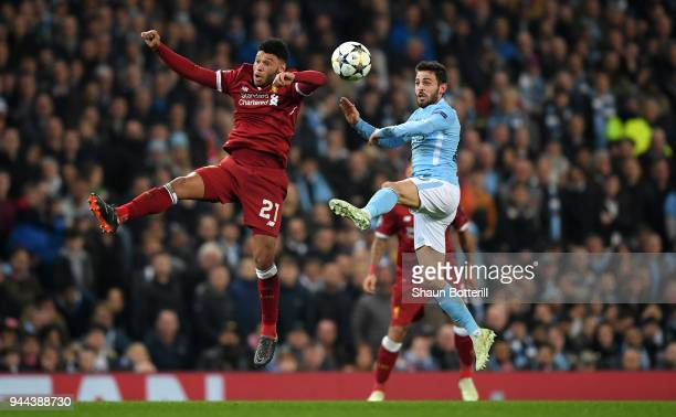 Alex OxladeChamberlain of Liverpool battles for possession with Bernardo Silva of Manchester City during the UEFA Champions League Quarter Final...