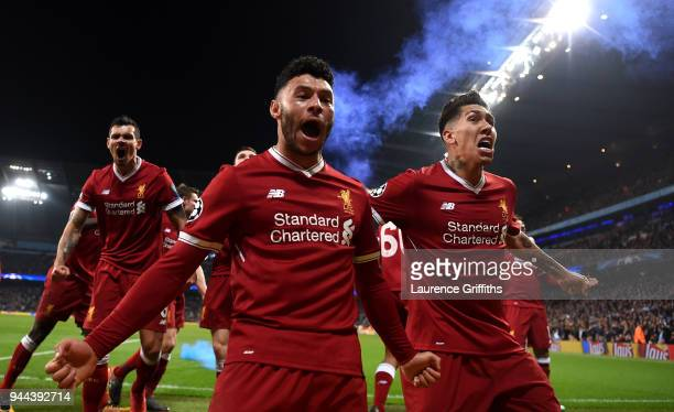 Alex OxladeChamberlain of Liverpool celebrates after his sides first goal during the UEFA Champions League Quarter Final Second Leg match between...